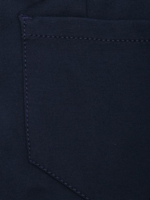 Укороченные брюки из трикотажа - Деталь