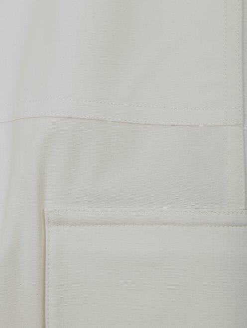 Брюки из шерсти с накладными карманами - Деталь